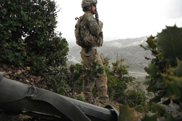 Army Sgt. Oscar Vazquez, a cavalry scout with the 1st Squadron, 40th Cavalry Regiment, 4th Infantry Brigade Combat Team (Airborne), 25th Infantry Division, looks over a valley during a combat patrol in May of 2012 near Combat Outpost Wilderness in the Paktya province, Afghanistan. Vasquez, who was originally born in Mexico, graduated high school in Phoenix, earned a bachelor's degree at Arizona State University, joined the Army and is now a U.S. citizen. (Courtesy Photo)