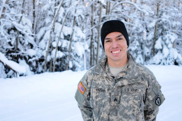 Sgt. Oscar Vazquez, a cavalry scout with the 1st Squadron, 40th Cavalry Regiment, 4th Infantry Brigade Combat Team (Airborne), 25th Infantry Division, pauses for a photo Dec. 16, 2013 at Joint Base Elmendorf Richardson, Alaska. Vasquez was born in Mexico. Through hard work, intelligence, and determination, he earned a bachelor's degree, an Army career and U.S. citizenship. (U.S. Army photo by Staff Sgt. Jeffrey Smith/Released)