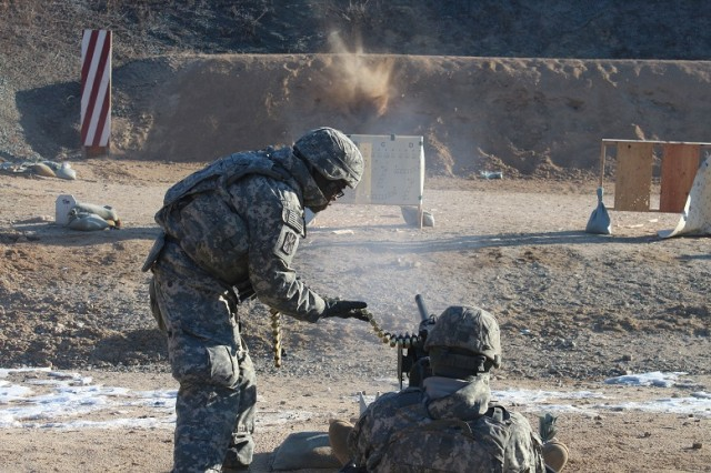 Spc. Zachary J. Staeven (right), an automated logistical specialist with Company F, 6-52 ADA Battalion, fires an M2 machine gun, assisted by Staff Sgt. Sloan Uys, a Patriot launching station enhanced operator/maintainer with Headquarters and Headquarters Battery, at Warrior Base, South Korea, Jan. 13.  Additionally, the Air Defenders practiced assembling, cleaning and maintaining the machine gun, among various other weapons systems. (Photo by Pfc. Shin, Young-Jae, 6-52 ADA Public Affairs)
