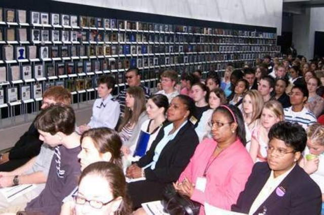 About 200 student participants in the Close-Up Foundation government program attend the DoD Women's History Month observance on March 30, 2005, at the Women's Memorial. Speakers encouraged them to think about careers in the defense workforce. The walls of the memorial's gallery were graced with the Faces of the Fallen exhibit of men and women who were killed in action in Iraq and Afghanistan.