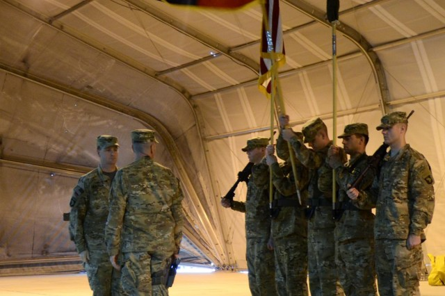 Col. Jimmy Blackmon, the commander of Task Force Thunder, 159th Combat Aviation Brigade, 101st Airborne Division (Air Assault), and Command Sgt. Major Ronald Dvorsky, the command sergeant major of Task Force Thunder, 159th CAB, 101st Airborne Division, look on as the 159th CAB colors are raised after being uncased during a transfer of authority ceremony at Bagram Air Field, Afghanistan, Jan. 18, 2014. The ceremony officially marked the transfer of authority for aviation operations in Regional Command East from Task Force Falcon to Task Force Thunder.