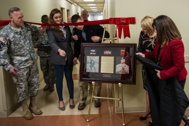 "The 7th Infantry Division honored one of its fallen, Dec. 27 with the dedication of a conference room to the memory of  Col. Darron Wright, former operations officer.  More than 200 soldiers, family and friends attended the ceremony honoring Wright, who died while conducting ""a standard MC-6 parachute jump at Sicily Drop Zone,"" according to a statement from Fort Bragg, N.C."