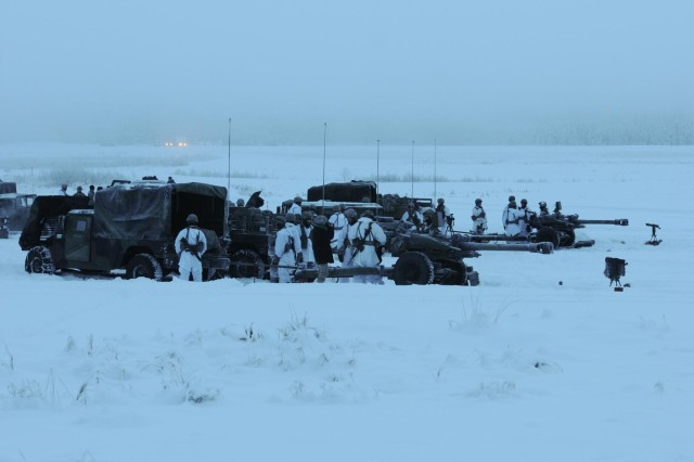 Paratroopers with the 2nd Battalion, 377th Parachute Field Artillery Regiment, 4th Infantry Brigade Combat Team (Airborne), 25th Infantry Division, prepare to fire 105mm Howitzers Dec. 18, 2013 at Joint Base Elmendorf-Richardson, Alaska. (U.S. Army photo by Sgt. 1st Class J.E. Epperson/Released)