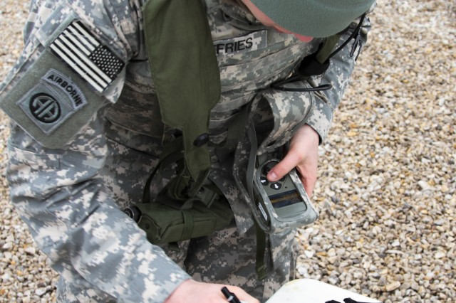 Sgt. Dustin Jeffries, a fire support specialist assigned to Headquarters and Headquarters Company, 1st Battalion, 325th Airborne Infantry Regiment, 2nd Brigade Combat Team, 82nd Airborne Division, uses a forward observer tablet to pinpoint the location of simulated round impacts during the brigade's testing of the new One Tactical Engagement Simulation System (OneTESS) at Fort Bragg, N.C., Jan. 16. The OneTESS system allows units to simulate the effects of indirect fire using the Multiple Integrated Laser Engagement System. (U.S. Army photo by Sgt. William Reinier, 2/82 PAO)