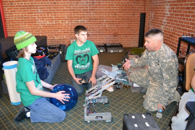 Maj. Gen. Todd Semonite discusses the VEX Robotics competition and the importance of Science, Technology, Engineering and Mathematics with competitors at the event taking place during the U.S Army All-American Bowl week in San Antonio, Texas.