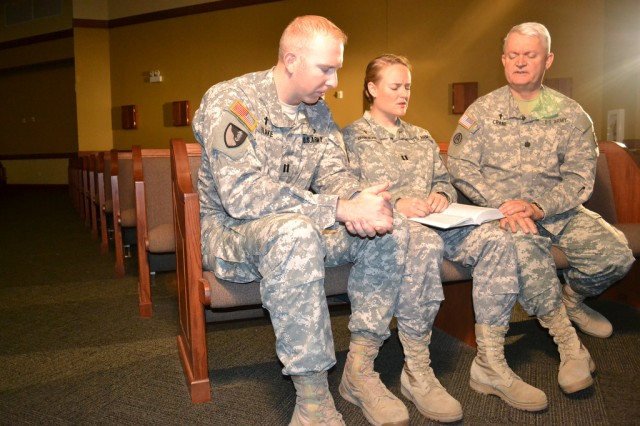 CH (Capt.) Aimee Crane-Blake (middle) prays with her father, CH (Lt. Col.) Brian Crane (right), and husband, CH (Capt.) Brian Blake (left). All three serve as U.S. Army chaplains at Fort Hood, Texas.