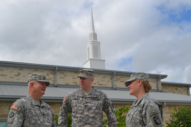Chaplain (Lt. Col.) Brian Crane (left) bonds with his daughter, CH (Capt.) Aimee Crane-Blake (right), and his son-in-law, CH (Capt.) Brian Blake (middle), over their shared service as U.S. Army chaplains at Fort Hood, Texas.
