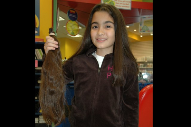 Torrales shows off her donation. She donated 15 inches of her own hair to benefit children suffering from long-term medical hair loss.