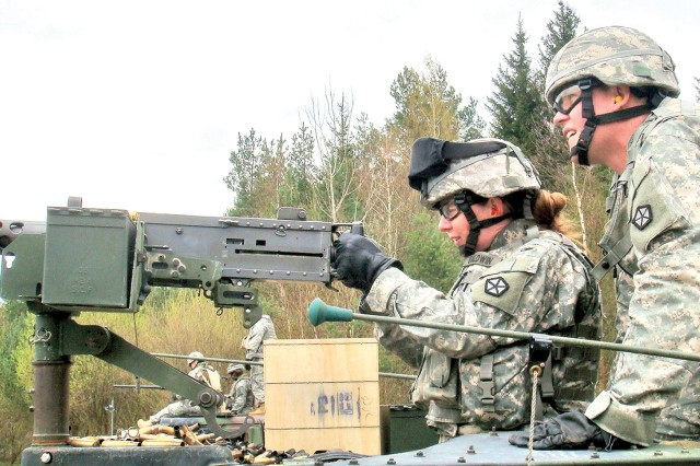 Master Sgt. Renee Baldwin fires a .50-caliber machine gun during training last summer at Joint Multinational Training Command's Grafenwoehr range in Germany.