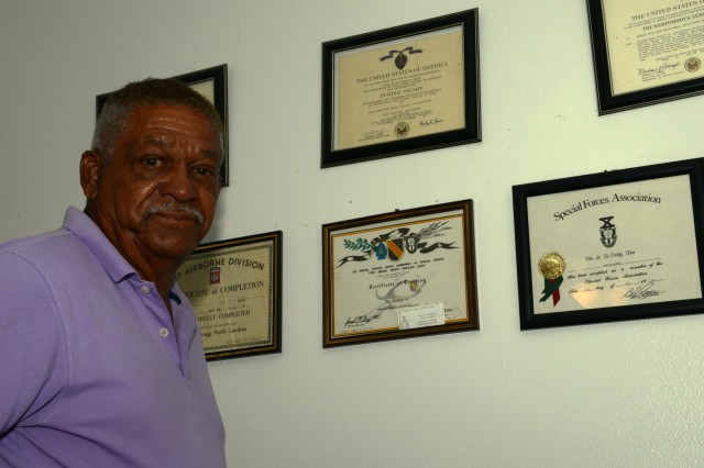 Retired Sgt. 1st Class Melvin Morris shows some of his Army awards that he keeps on display at his Florida home, May 22, 2013.