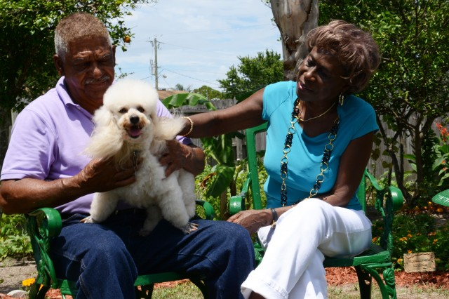 Melvin and Mary Morris, who have been married for more than 50 years, play with their dog Lucky at their Florida home, May 22, 2013.
