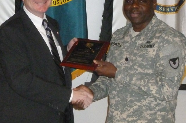 Michael Hutchison, ACC deputy to the commanding general, presents Lt. Col. Jeffrey L. Caldwell, ACC-RSA, his plaque as the Outstanding Active Duty Military Officer/ NCO (Major Weapons Systems).