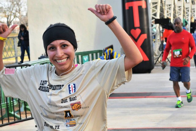 An elated 2nd Lt. Genevieve Pena, a human resources officer for the 120th Infantry Brigade, finished third in her age bracket in the 11th Annual Miracle Match Marathon in Waco, Texas, Sunday.