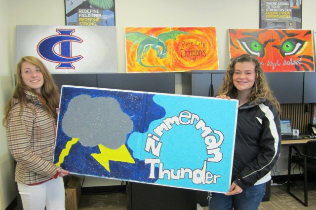Madison Lamosse and Ellie Merwin from Zimmerman High School in Zimmerman, Minn., display their entry for the ceiling tile contest.