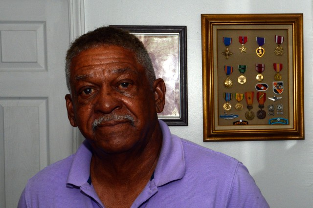 Retired Sgt. 1st Class Melvin Morris is seen next to his shadowbox of military honors, at his Florida home, May 22, 2013.