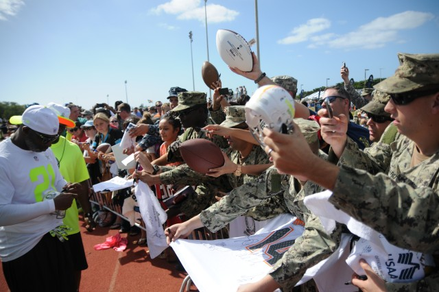 "JOINT BASE PEARL HARBOR-HICKAM, Hawaii "" Deion Sanders, one of the two Pro Bowl coaches signs autographs during a practice held at Joint Base Pearl Harbor-Hickam Jan. 23. This is the first year that the two teams will have non-conference players playing against each other."