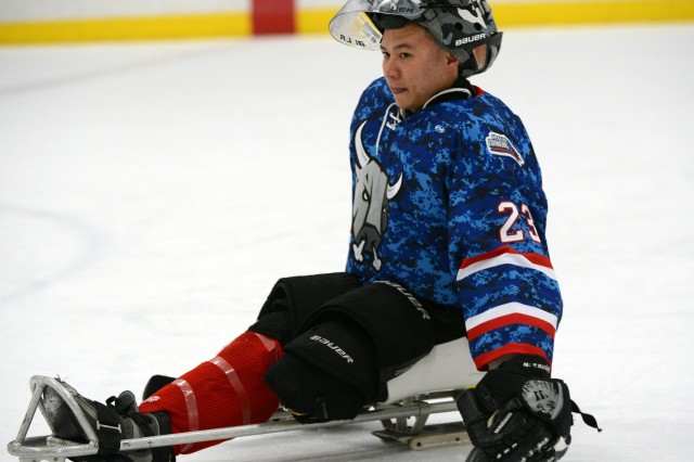 U.S. Army World Class Athlete Paralympic Program goaltender Sgt. Jen Lee, an above the left knee amputee, takes a break from play during a showdown between his San Antonio Rampage Sled Hockey Team and the visiting Colorado Avalanche. Lee was selected to play for Team USA in the 2014 Paralympic Winter Games in Sochi, Russia.