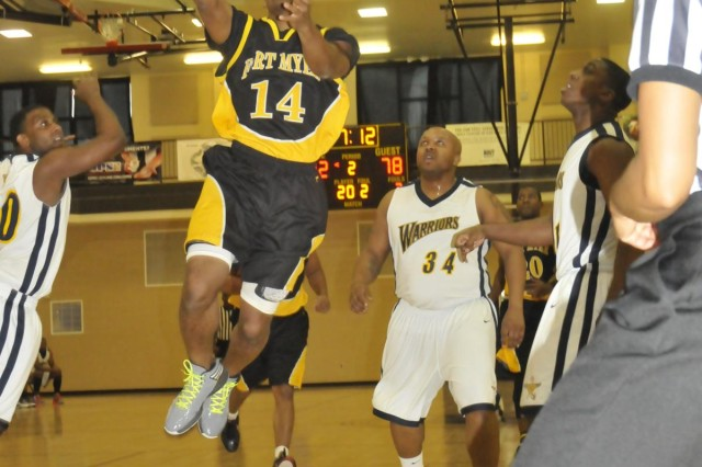 Fort Myer General Albert Glover flies high in the lane with a second half layup during the team's 91-60 victory against the NSA Bethesda Warriors Jan. 25 at the Walter Reed National Medical Center fitness center. The game was the Washington Area Military Athletic Conference opener for both teams.