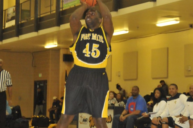 Fort Myer General Deon Coleman pulls up for a jump shot against the NSA Bethesda Warriors in the first half of a 91-60 victory at the Walter Reed National Medical Center fitness center Jan. 25. After the opening weekend of Washington Area Military Athletic Conference play, the Generals sport a 2-0 record.