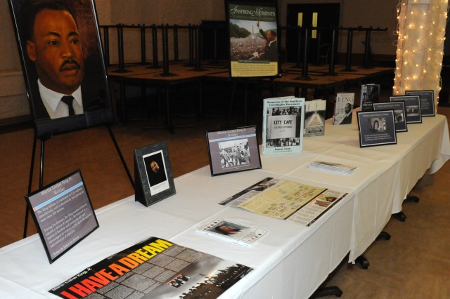 Posters, books and paintings are on display during the Dr. Martin Luther King Jr. observance in Heritage Hall at Rock Island Arsenal, Ill., Jan. 23. (Photo by Sgt. 1st Class Shannon Wright, ASC Public Affairs)