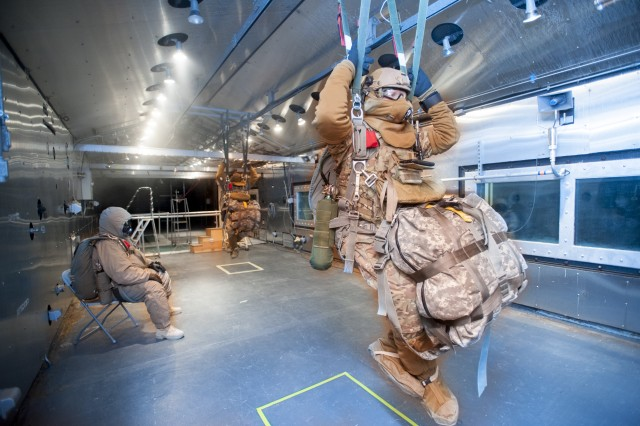 Retired military paratroopers were suspended from the ceiling of the Natick Soldier Research, Development and Engineering Center's Doriot Climatic Chambers as engineers tested oxygen and navigation systems as the wind chill hovered near 50 degrees below zero.