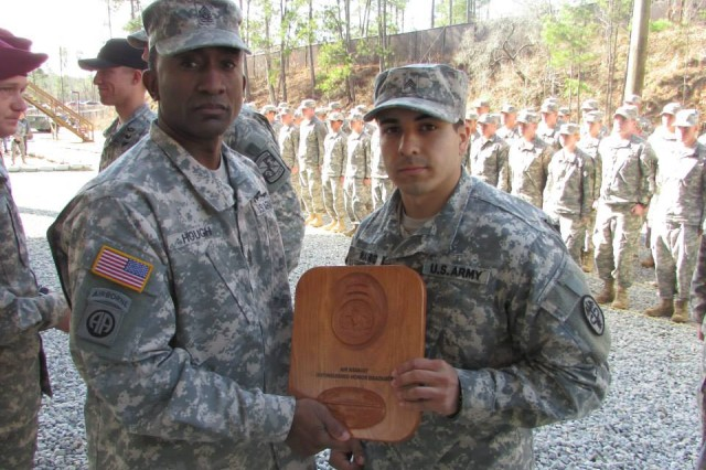 Sgt. Jesse Madrid, DENTAC, receives his Air Assault Class Honor Graduate plaque Jan. 17 from Command Sgt. Maj. Diamond Hough, 14th Combat Support Hospital.