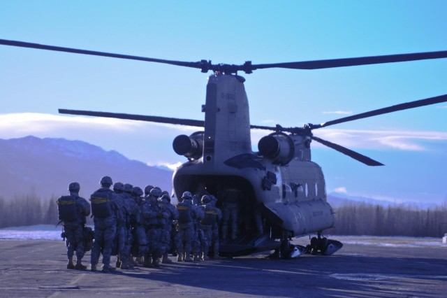 Paratroopers with Comanche Company, 1st Battalion, 501st Infantry Regiment, 4th Infantry Brigade Combat Team (Airborne), 25th Infantry Division, board a CH-47 Chinook Helicopter at Bryant Army Airfield on Joint-Base Elmendorf Richardson, Alaska, Jan. 29, 2014. The jump is one of many ongoing operations during the nine-day brigade-wide field training exercise to validate the Army's only active airborne force for the Asia-Pacific region.