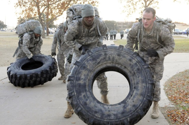 Special Operations candidates conduct tire flipping drills as part of their enhanced physical training regiment while training for Special Forces Assessment and Selection with the Special Operations Recruiting Battalion, at Fort Hood, Texas. Soldiers continue to train and develop their skills before they are allowed to proceed to the course, at Fort Bragg, N.C.