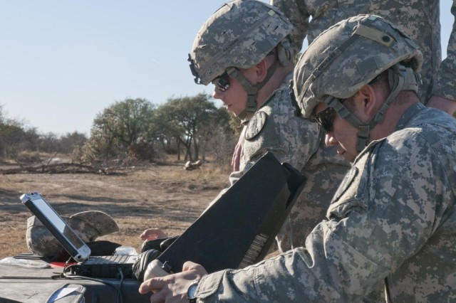 Pfc. Cole Clark (left), an MP with 64th Military Police Company, 720th MP Battalion, and Sgt. Larry Clavette (right), an MP with 64th Military Police Company, 720th MP Battalion, perform their pre-flight functions checks for their RQ-11 unmanned aircraft system, Jan. 15, 2014, at Fort Hood, Texas, during a Raven certification course. The Raven is a small unmanned aircraft system capable of enhancing a military unit's situational awareness through night and day surveillance operations.
