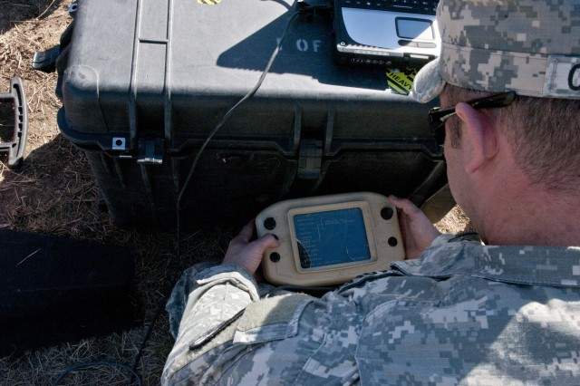 FORT HOOD, Texas -- Sgt. Larry Clavette, a team leader with 64th Military Police Company, 720th MP Battalion, sends commands to his RQ-11 Raven unmanned aerial vehicle via a controller for his preflight functions checks Jan. 15, 2014, at Fort Hood during a Raven certification course. The course, which runs two weeks, gives students the knowledge to operate Ravens in a deployed environment. (U.S. Army photo by Sgt. Samuel Northrup, 7th Mobile Public Affairs Detachment)