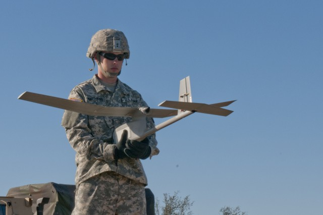FORT HOOD, Texas -- Spc. Brandon Matthews, a driver with 64th Military Police Company, 720th MP Battalion, holds an RQ-11 Raven unmanned aerial vehicle during a preflight functions check Jan. 14, 2014, at Fort Hood. Soldiers from 64th MP Company participated in a two-week Raven certification program to ready themselves for their upcoming National Training Center mission at Fort Irwin, Calif. (U.S. Army photo by Sgt. Samuel Northrup, 7th Mobile Public Affairs Detachment)