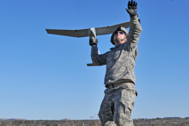 FORT HOOD, Texas -- Pfc. Cole Clark, an MP with 64th Military Police Company, 720th MP Battalion, prepares to hand-launch an RQ-11 Raven into the air Jan. 15, 2014, at Fort Hood. Ravens are hand-launched small unmanned aerial vehicle that are controlled by a ground station and can be programmed to fly autonomously using GPS. (U.S. Army photo by Sgt. Samuel Northrup, 7th Mobile Public Affairs Detachment)