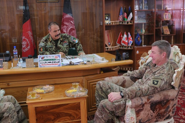 """LAGHMAN PROVINCE, Afghanistan �"""" U.S. Army Maj. Gen. James McConville sits and talks with Afghan Maj. Gen. Mohammed Zaman Waziri, commander, 201st Afghan National Army Corps, during McConville�'s final visit to Forward Operating Base Gamberi, Jan. 29, 2014. McConville wraps up his time as commander of Regional Command East�'s Combined Joint Task Force-101.  (U.S. Army Photo by Sgt. 1st Class E. L. Craig, Task Force Patriot PAO)"""