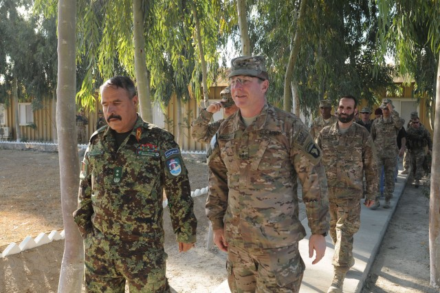 """LAGHMAN PROVINCE, Afghanistan �"""" U.S. Army Maj. Gen. James McConville (right) walks with Afghan Maj. Gen. Mohammed Zaman Waziri, commander, 201st Afghan National Army Corps, during McConville�'s final visit to Forward Operating Base Gamberi, Jan. 29, 2014. McConville wraps up his time as commander of Regional Command East�'s Combined Joint Task Force-101. (U.S. Army Photo by Sgt. 1st Class E. L. Craig, Task Force Patriot PAO)"""