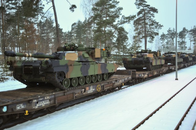 U.S. Army M1A2 Abrams tanks arrive at the Grafenwoehr Training Area, Jan 31, 2014. The vehicles are part of the European Activity Set, a combined-arms battalion-sized set of vehicles and equipment pre-positioned at the Grafenwoehr Training Area designed to support the U.S. Army�'s European Rotational Force and the NATO Response Force during training exercises and real-world missions.  The 1st Brigade, 1st Cavalry Division will be the first European Rotational Force unit to use the EAS this spring and summer during training exercises throughout the U.S. European Command area of responsibility.(U.S. Army Photo by Markus Rauchenberger)
