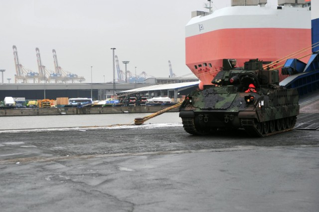 A Bradley Fighting Vehicle drives off the Independence II vessel at Bremerhaven Port Jan. 24. The Bradley is one of more than 30 assigned to the European Activity Set, which will allow U.S. regionally aligned forces and multinational partners in Europe to operate as the European Response Force and NATO Response Force.