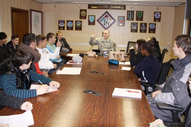 German students practice their English language skills by interviewing Lt. Col. Michael Sullivan, U.S. Army Garrison Baumholder commander.