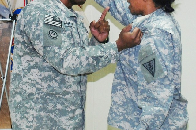 1st Lt. Tashima McMurray, SHARP victim advocate, and Staff Sgt. Desmond Porter, personnel noncommissioned officer, both from the 3rd Medical Command (Deployment Support), perform a skit depicting an incident where a Soldier is assaulted and later threatened.