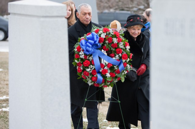 """Charles F. Bolden (left), National Aeronautics and Space Administration administrator, and June Scobee Rodgers, widow of Space Shuttle Challenger's Commander Lt. Col. Francis R. """"Dick"""" Scobee, walk toward the Challenger Memorial in Arlington National Cemetery, Va., to lay a wreath during the NASA Day of Remembrance, Jan. 31, 2014. The Space Shuttle Challenger exploded after takeoff, Jan. 28, 1986."""