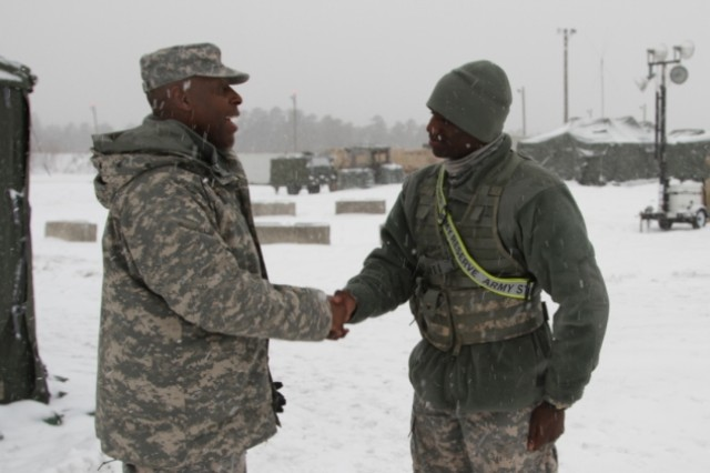 Spc. Mawuli Apeti, right, receives a coin from Brig. Gen. Michael Dillard for a job well done during the Warrior Exercise rotation at Joint Base McGuire-Dix-Lakehurst, N.J.,  Jan. 25.