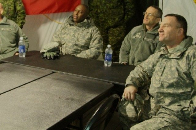 From left, Brig. Gen. Mitchell Chitwood, Brig. Gen. Michael Dillard, Brig. Gen. Michael Mann, and Brig. Gen. I. Neal Black listen as officers from the 863rd Engineer Battalion explain their operation during  the Warrior Exercise rotation at Joint Base McGuire-Dix-Lakehurst, N.J.  Jan. 25.