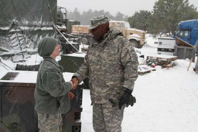 Spc. Morgana Lindey receives a coin from Brig. Gen. Michael Dillard for a job well done during the Warrior Exercise rotation at Joint Base McGuire-Dix-Lakehurst, N.J.,  Jan. 25.