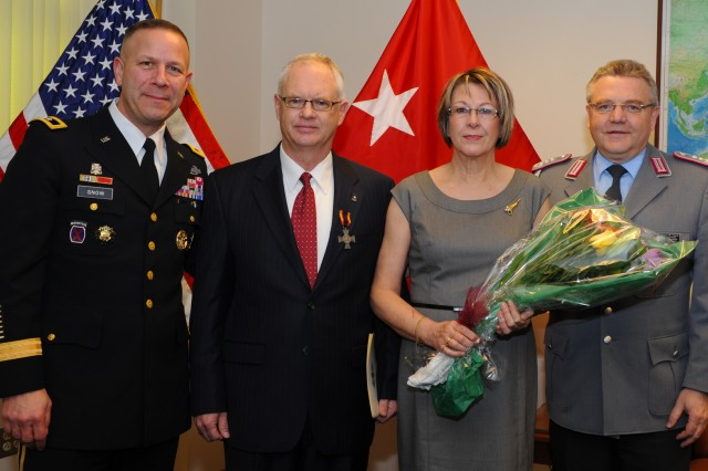 John C. Wirick (second from left) was presented the German Silver Cross of Honor of the Bundeswehr, at a Pentagon ceremony, Jan. 30, 2014. From left to right: Maj. Gen. Jeffrey J. Snow, Wirick, Angelika Wirick and German Army Military Attache Col. Klaus Finck.