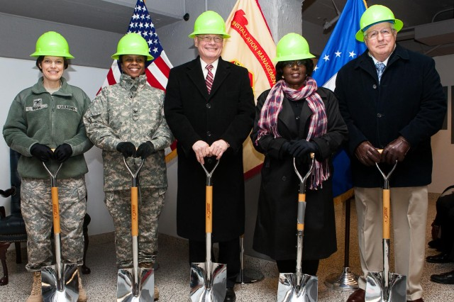The official party for the Jan. 28 groundbreaking ceremony of the new communications building at Joint Base Myer-Henderson Hall pose for a photograph. From left, Col. Maria A. Biank, commander, 93rd Signal Brigade, Fort Eustis; Col. Fern O. Sumpter, commander, Joint Base Myer-Henderson Hall; Egon F. Hawrylak, deputy commander (SES), Joint Force Headquarters National Capital Region and the U.S. Army Military District of Washington; Lynise K. Wright, director, Network Enterprise Center, Joint Base Myer-Henderson Hall deputy director, NEC-NCR; and Peter Thompson, Senior Vice President of Operations, Black Box Network Services Government Solutions.