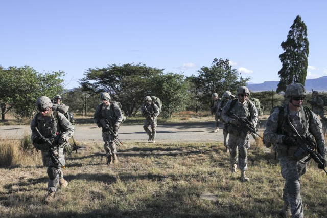 Paratroopers from Charlie Company, 1st Battalion, 325th Airborne Infantry Regiment of Fort Bragg, N.C., complete a tactical ruck march back from spending the night in the airfield after a parachute drop as an exercise for Shared Accord 13, at Bulembo, South Africa, July 28, 2013. Shared Accord is a biennial training exercise which promotes regional relationships, increases capacity, trains U.S. and South African forces, and furthers cross-training and interoperability.