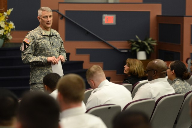 Sgt. Maj. of the Army Raymond F. Chandler III speaks at a town hall at Fort Belvoir, Va., Feb. 3, 2014, about the responsibilities Soldiers have in protecting one another from sexual assault, helping a battle buddy at risk for suicide, and creating a safe environment for all members.