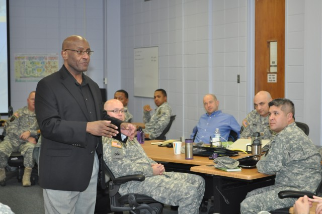 Dwayne A. Morton, Functional Area 51 Intermediate Qualification Course director, Army Acquisition Center of Excellence, opens a Mobile Training Team class session about hiring Army contracting interns.