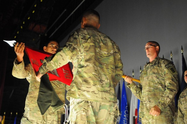 The command team of the 15th Explosives Hazards Team, 130th Engineer Brigade, Capt. Vincent Ramos (left) and Master Sgt. Francisco Alcantar (right), uncase their unit's colors during a redeployment ceremony signifying the official return of their unit and its soldiers, Feb. 3, at the Sgt. Smith Theater on Schofield Barracks.