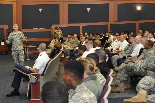 Sgt. Maj. of the Army Raymond Chandler III speaks to Soldiers about battle buddy safety among others things at a town hall meeting at Fort Belvoir's Thurman Hall Feb. 3. Chandler emphasized to Soldiers that safety extends to creating a protective environment for others to work.