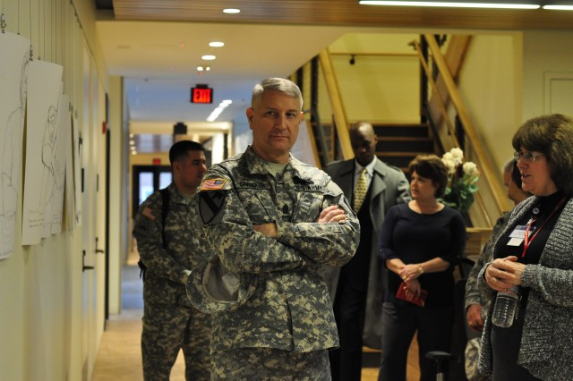 USO Warrior and Family Center Manager Pamela Horton shows Sgt. Maj. of the Army Raymond Chandler III around the USO facility Feb. 3. Chandler visited Fort Belvoir to tour the base and speak to Soldiers about professionalism, commitment and the future of the Army.